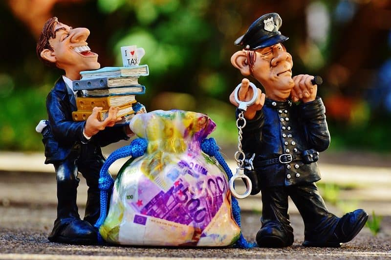 tax evasion and cop figurines